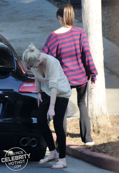 EXC: Lindsay Lohan Checks Her Porsche For Problems in LA