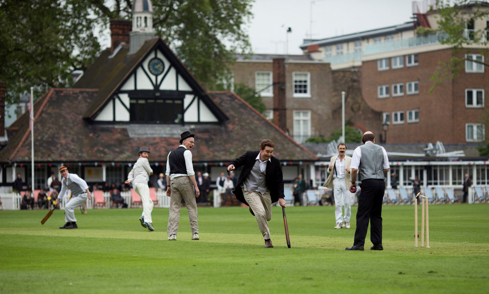 . The ball knocks the bails off the stumps as a batsman, third right, runs in an attempt to get in safe during a Victorian-era costume themed cricket match on a wicket in Vincent Square, central London, Wednesday, May 29, 2013. The two-over-a-side Victorian match was held Wednesday to mark the launch of the 150th anniversary edition of the Wisden Cricketers\' Almanac.  (AP Photo/Matt Dunham)