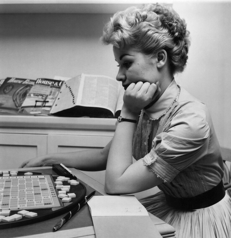 . Patti Page, the TV singing star, is deep in thought as she plays a game of Scrabble in her New York apartment, Sept. 25, 1956. Miss Page has many busy days ahead. She is scheduled to make appearances shortly on Ed Sullivan?s and Perry Como?s television shows. (AP Photo/John Bennewitz) No Sales