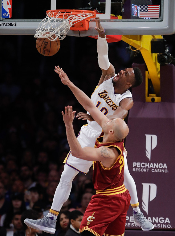 . Los Angeles Lakers\' David Nwaba, top, dunks over Cleveland Cavaliers\' Richard Jefferson during the second half of an NBA basketball game Sunday, March 19, 2017, in Los Angeles. The Cavaliers won 125-120. (AP Photo/Jae C. Hong)