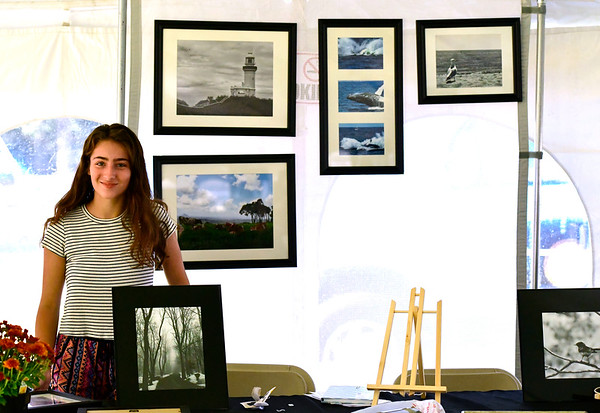 9/20/2019 Mike Orazzi | StaffrBritni Pastrynak with some of her photography for sale during the Mum Festival on Friday evening in Bristol.