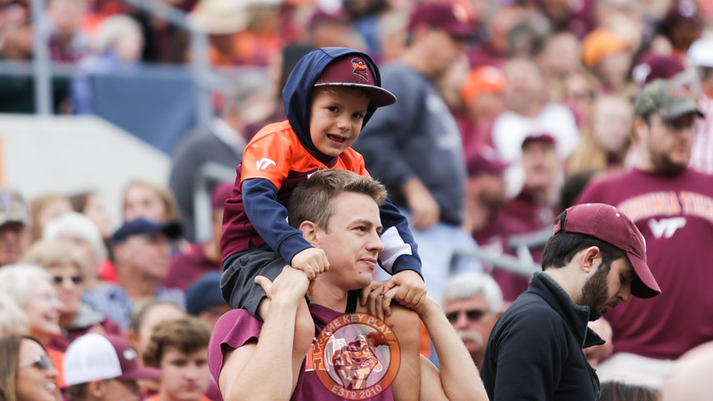 A young fan is carried on shoulders in the East Stands during the game. (Mark Umansky/TheKeyPlay.com)