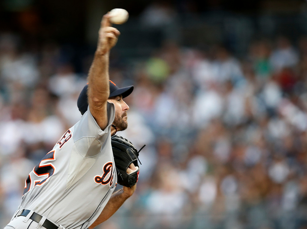. Detroit Tigers starting pitcher Justin Verlander delivers in the first inning of a baseball game against the New York Yankees at Yankee Stadium in New York, Wednesday, Aug. 6, 2014.  (AP Photo/Kathy Willens)