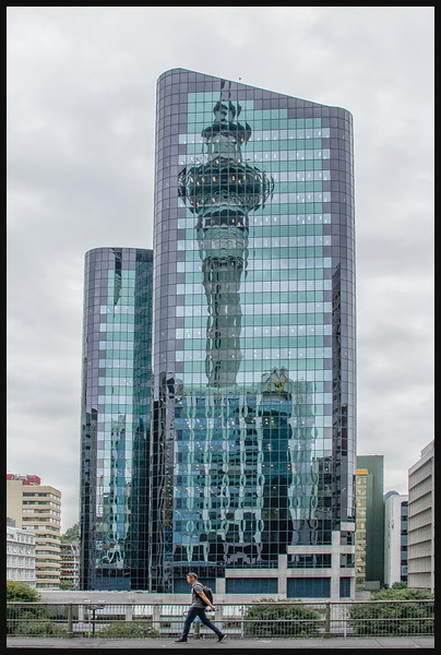 """Reflection of the Sky Tower. Sky Tower is 328 metres; 1,076 feet, """"higher than Sydney's tower."""" Tallest man-made structure in the southern hemisphere."""
