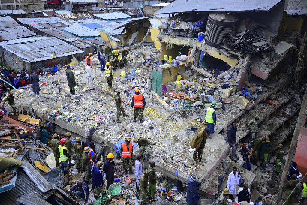 . Kenyan emergency personnel look for survivors under the rubble of a collapsed building in Nairobi on April 30, 2016. Torrential rainstorms in the Kenyan capital have left at least 14 people dead, police said, including at least seven crushed when a six-story building collapsed, as rescue teams shifted rubble in a desperate search for survivors. / AFP PHOTO / JOHN MUCHUCHA/AFP/Getty Images