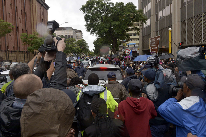 . Members of the media and the public surround the vehicle of South African Paralympian star Oscar Pistorius, accused of murdering his girlfriend Reeva Steenkamp, as he leaves the Pretoria\'s North Gauteng High Court on March 3, 2014, on the opening day of his trial. Pistorius, 27, appeared in court and on television screens around the world to answer charges that he willfully shot his girlfriend Reeva Steenkamp dead on Valentine\'s Day 2013 through a locked bathroom door at his home in the city, and faces a life sentence if convicted.  (ALEXANDER JOE/AFP/Getty Images)