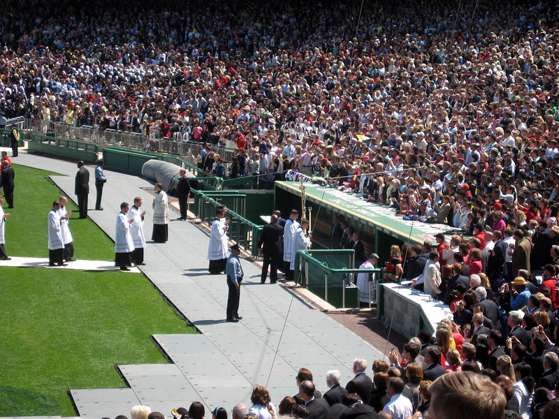 Pope Benedict XVI's procession leaves the stadium through the Nationals' dugout after the Mass