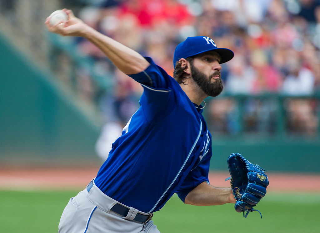 . Kansas City Royals starting pitcher Jason Hammel delivers to Cleveland Indians\' Carlos Santana during the first inning of a baseball game in Cleveland, Saturday, Sept. 16, 2017. (AP Photo/Phil Long)