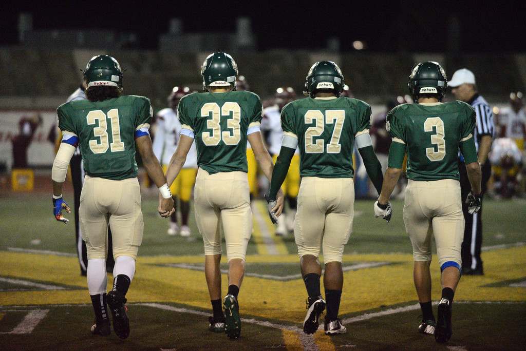 . Mira Costa captains walk to the coin toss. -half game action in the CIF Southern Section Northern Division first-round football game between the Highland High School Bulldogs and Mira Costal Mustangs at Costa Friday evening, 11/15/2013.  Photo for The Daily Breeze by Axel Koester, 11/15/2013.