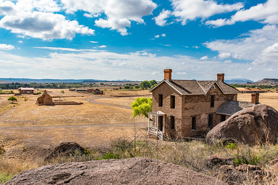 Panoramic view of old brick structure on miliary post in west Texas