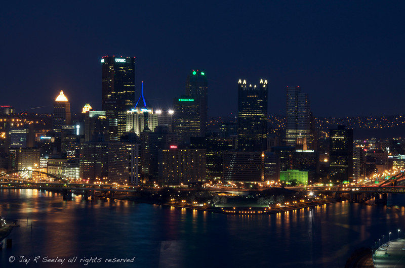 Downtown Pittsburgh at night.  The 3 convering rivers can be easily seen