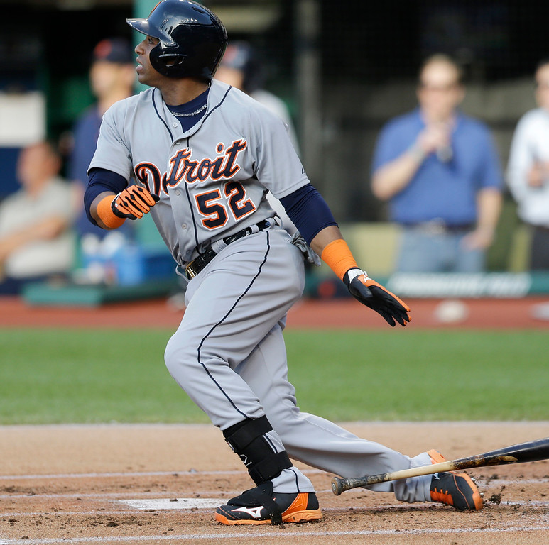 . Detroit Tigers\' Yoenis Cespedes hits a RBI-double off Cleveland Indians starting pitcher Trevor Bauer in the first inning of a baseball game, Monday, June 22, 2015, in Cleveland. Ian Kinsler scored on the play. (AP Photo/Tony Dejak)