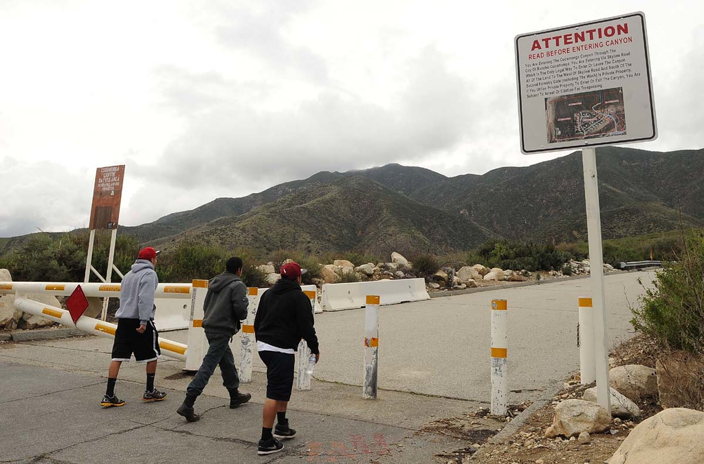 . Andres Escobedo,left, 20, Victor Nava, Center 16, and Juan Aguilar, 18  all from Rancho Cucamonga walk the path into the canyon hiking area off Skyline Drive Thursday March 7, 2013 in Rancho Cucamonga. A sign at the gate brings attention to the risks involved and recent fatalities at scenic falls area inside the canyon.  (Staff photo/Inland Valley Daily Bulletin)