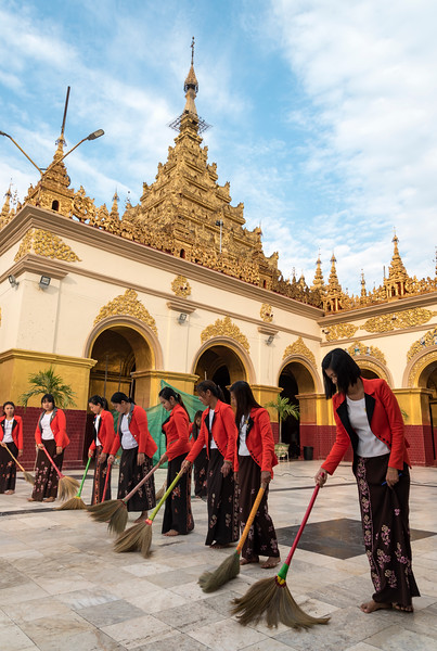 Burmese women sweep the floor around the Mahamuni Paya in Mandalay, Burma - Myanmar