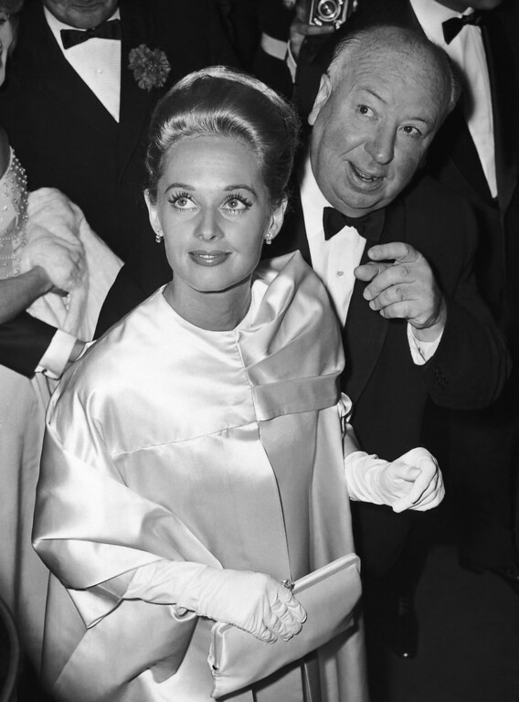 . British film director and producer Alfred Hitchcock and his blond protegee Tippi Hedren, arrive on May 9, 1963 at the festival theatre in Cannes, France, for the screening of their film, ?The Birds?. The chilling suspense film, which stars Miss Hedren, was chosen to open the 16th annual Cannes Film Festival although it was not in competition for a gold palm, the festival equivalent of Hollywood?s Oscar. (AP Photo)