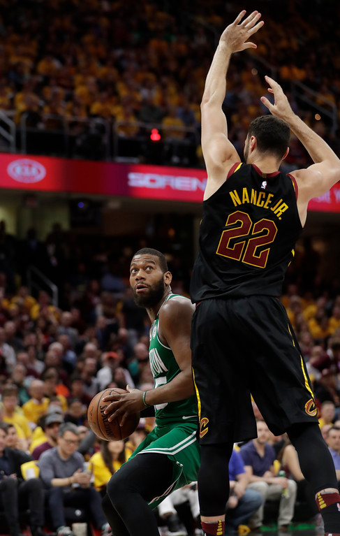 . Boston Celtics\' Greg Monroe (55) looks past Cleveland Cavaliers\' Larry Nance Jr. (22) in the second half of Game 3 of the NBA basketball Eastern Conference finals, Saturday, May 19, 2018, in Cleveland. (AP Photo/Tony Dejak)