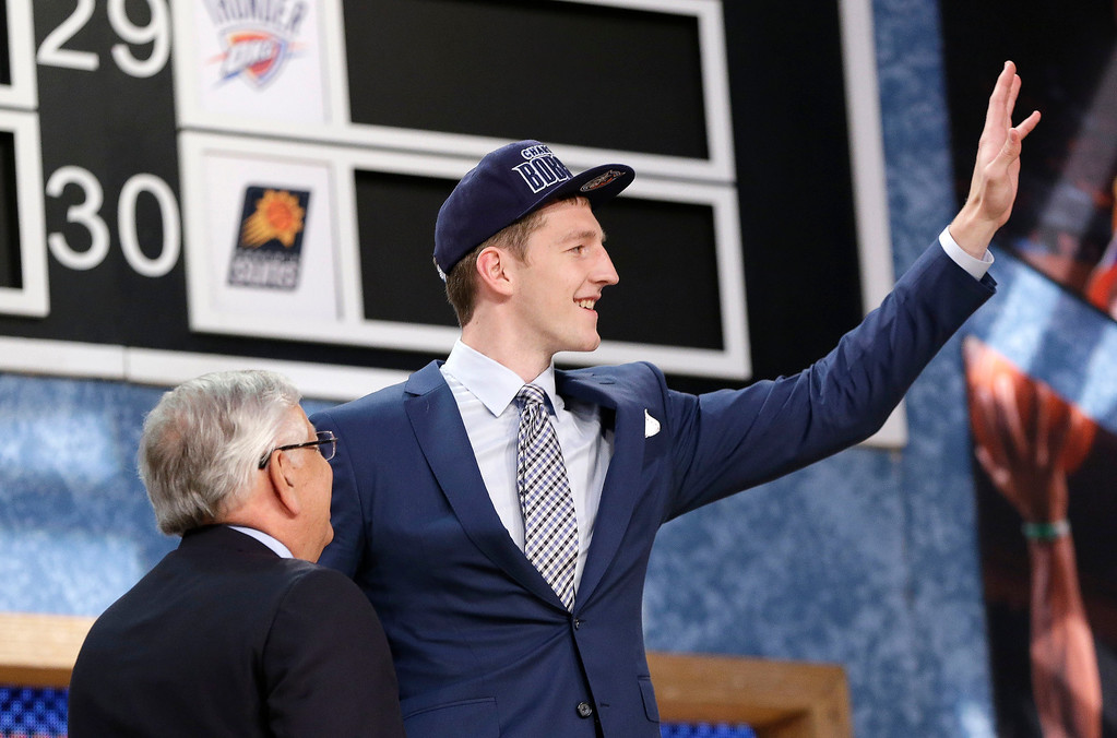 . NBA Commissioner David Stern, left, watches as Indiana\'s Cody Zeller waves after being selected by the Charlotte Bobcats in the first round of the NBA basketball draft, Thursday, June 27, 2013, in New York. (AP Photo/Kathy Willens)