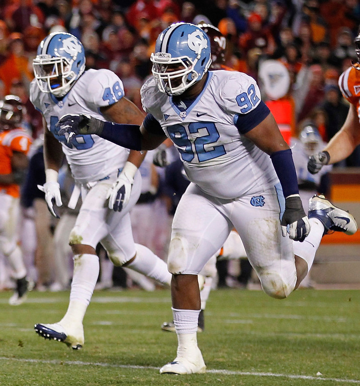 . North Carolina defensive tackle Sylvester Williams #92 of the runs downfield on November 17, 2011 in Blacksburg, Virginia. Williams was selected 28th by the Denver Broncos in the 2013 NFL Draft. (Photo by Geoff Burke/Getty Images)