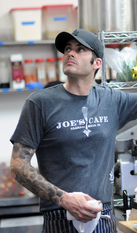 """. Chef Joe Wetherbee checks food tickets at Joe\'s Cafe in Granada Hills, CA on Wednesday, March 19, 2014.  Chef and Co-owner Joe Wetherbee won the Food Network\'s \""""Chopped, \""""Dread and Breakfast\"""" episode which aired on Tuesday night.  (Photo by Dean Musgrove/Los Angeles Daily News)"""