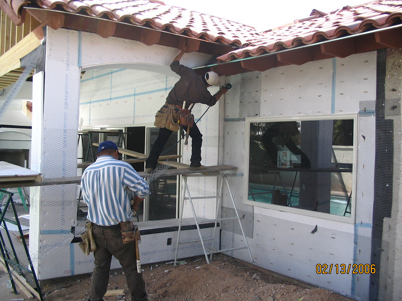 Putting up the foam, after which the stucco will go on.