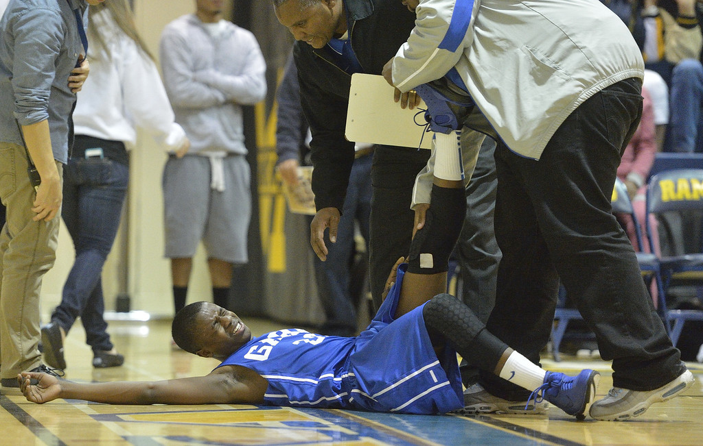 . LONG BEACH, CALIF. USA -- Gahr\'s Jeremy Carlyle (20) is injured in the final minutes of their game against Millikan during their CIF-SS Divison 1-A playoff game in Long Beach on February 15, 2013. Millikan defeated Gahr, 74 to 64. Photo by Jeff Gritchen / Los Angeles Newspaper Group