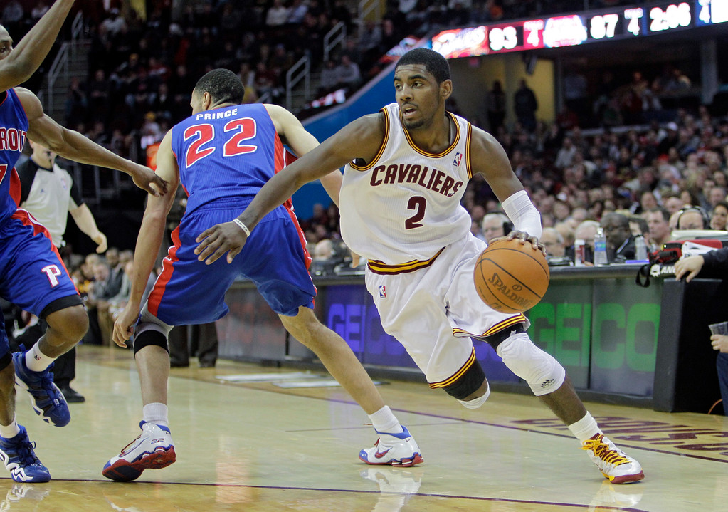 . Cleveland Cavaliers\' Kyrie Irving (2) drives against the Detroit Pistons in an NBA basketball game Tuesday, Feb. 21, 2012, in Cleveland. (AP Photo/Mark Duncan)