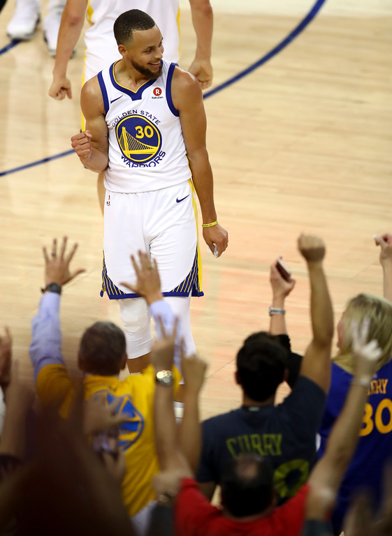 . Golden State Warriors guard Stephen Curry (30) celebrates in front of fans after scoring against the Cleveland Cavaliers during the first half of Game 1 of basketball\'s NBA Finals in Oakland, Calif., Thursday, May 31, 2018. (AP Photo/Ben Margot)