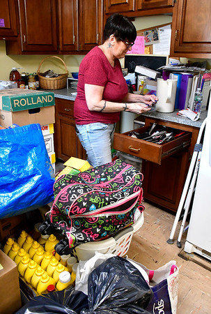 8/9/2019 Mike Orazzi | Staff Kim Margelot packs up kitchen items at Brian's Angels while preparing for their move on Friday morning.