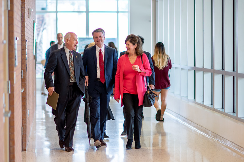 President Emeritus Dr. Robert Furgason (left) walks with guests to the TAMU-CC Furgason Engineering Building naming ceremony luncheon on December 7, 2018 at Texas A&M University-Corpus Christi.
