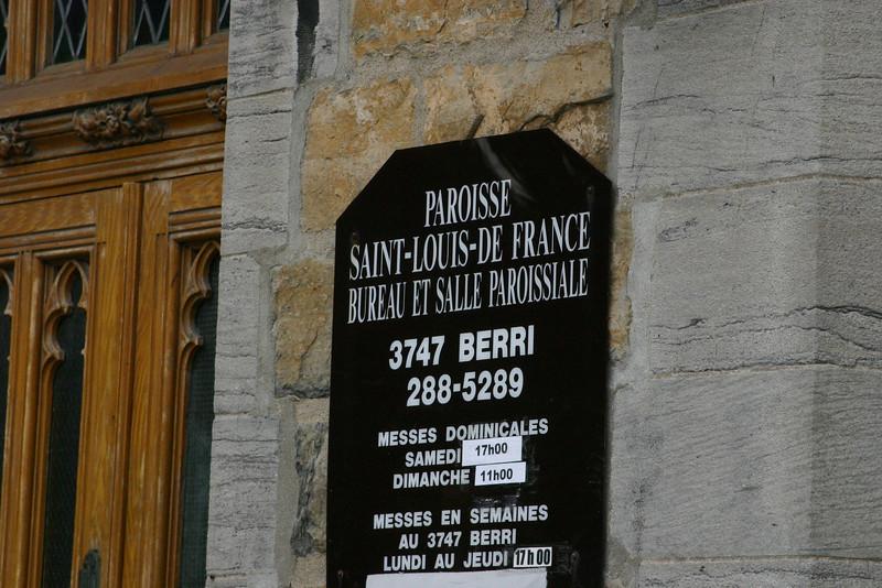 "This sign simply identifies the preceding church front. ""Paroisse Saint-Louis-De France Bureau et Salle Paroissiale"" (Parish Saint-Louis- of France Office and Church hall)."
