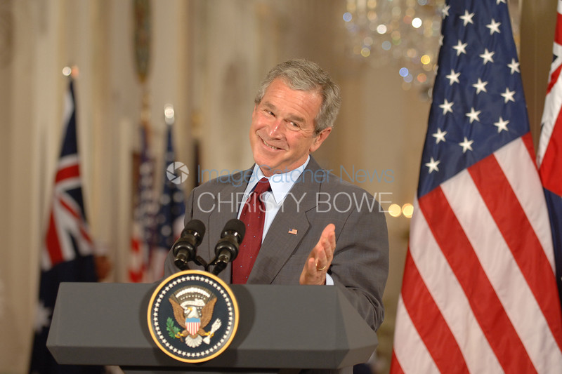 A candid moment during a Press Conference in The East Room of The White House.