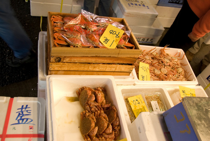 Assortment of crabs at a fish vendor stall in Tsukiji Fish Market, Tokyo, Japan