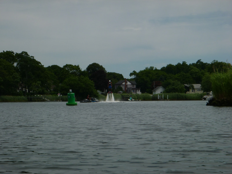Kayaking down the Peconic River, we see News12 filming a segment for the East End.