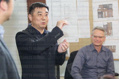 Chinese businessman Tom Yang and his Create World America is seen with American developer Kevin Daniels in Bellevue, Washington