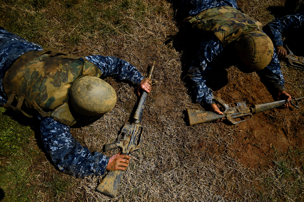 . Members of the United States Naval Academy freshman class perform calisthenic exercise while wearing body-armour during the annual Sea Trials training exercise at the U.S. Naval Academy on May 13, 2014 in Annapolis, Maryland. (Photo by Patrick Smith/Getty Images)