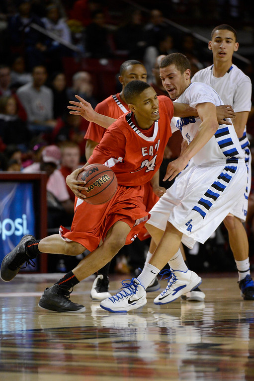 . DENVER, CO. - FEBRUARY 09: Dominique Collier (24) of East drives around Evan Motlong (3) of Highlands Ranch February 9, 2012 at Magness Arena.  East defeated Highlands Ranch 73 - 54. (Photo By John Leyba/The Denver Post)