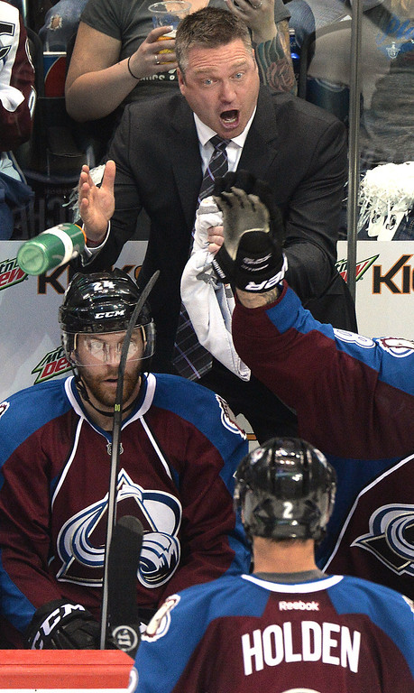 . Colorado coach Patrick Roy shared his thoughts with defenseman Nick Holden in the third period. The Avs beat the Wild to win 5-4 in overtime to take a 1-0 game lead over Minnesota in the first round of the NHL playoffs Thursday night, April 17, 2014.  (Photo by Karl Gehring/The Denver Post)