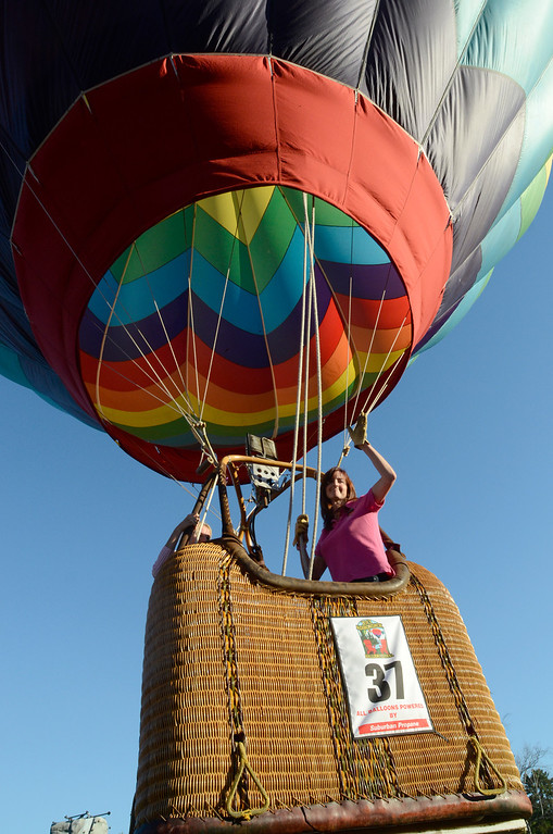 . Balloonist Kimberly Hawkins of Munnsville, N.Y. waves to the crowd below as she lifts off from Crandall Park in Glens Falls Thursday evening during the opening night of the Adirondack Hot Air Balloon Festival. Photo Ed Burke/SARATOGIAN 9/19/13
