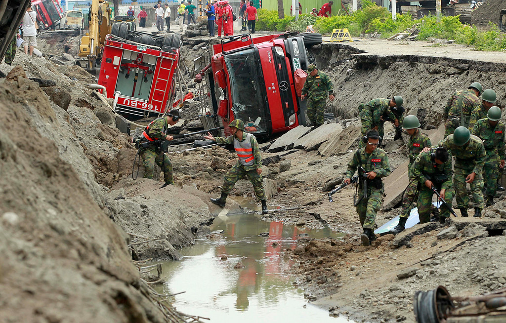 . Soldiers use electronic sensors to search for missing persons in massive gas explosions in Kaohsiung, Taiwan, Friday, Aug. 1, 2014. A series of explosions about midnight Thursday and early Friday ripped through Taiwan\'s second-largest city, killing scores of people, Taiwan\'s National Fire Agency said Friday. (AP Photo/Wally Santana)