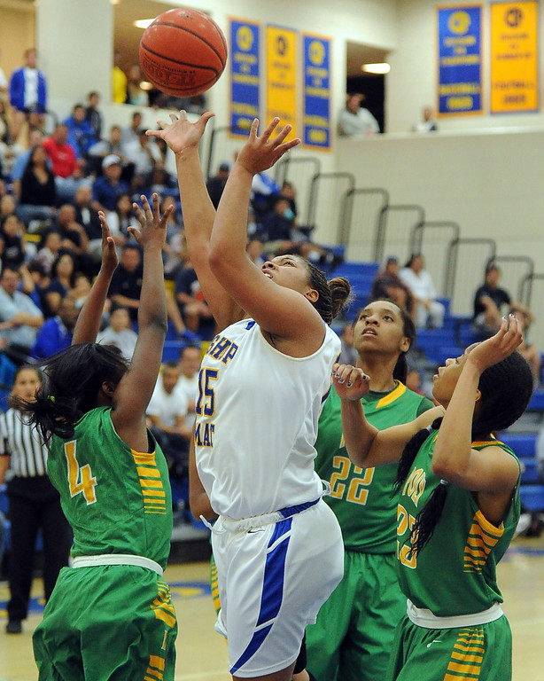. Bishop Amat\'s Leeah Powell (15) drives to the basket against Long Beach Poly in the second half of a CIF State Southern California Regional semifinal basketball game at Bishop Amat High School on Tuesday, March 12, 2013 in La Puente, Calif. Long Beach Poly won 52-34.  (Keith Birmingham Pasadena Star-News)