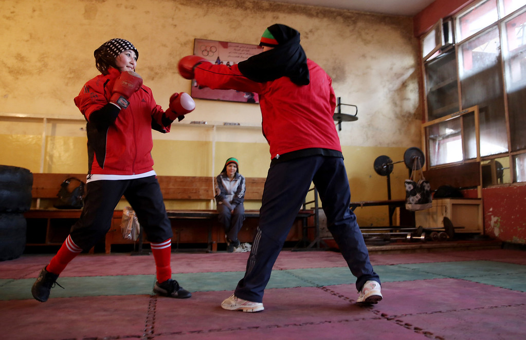 . In this Wednesday, March, 5, 2014 photo, Afghan female boxers practice at the Kabul Stadium boxing club, Afghanistan. The women, who are 18 and older, donít have much more than determination, and a trainer who runs them through their paces, watches as they spar, corrects their technique, tells them when to jab, how to protect themselves, when to power through with a left and then a right. (AP Photo/Massoud Hossaini)