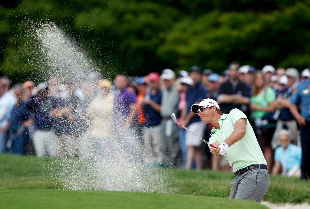 . Belgium\'s Nicolas Colsaerts hits from a sand trap to the first green during the second round of the 2013 U.S. Open golf championship at the Merion Golf Club in Ardmore, Pennsylvania, June 14, 2013.  REUTERS/Matt Sullivan