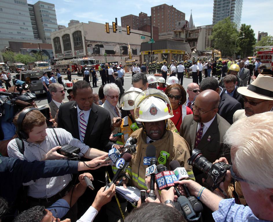 . Philadelphia Fire Commissioner Lloyd Ayers addresses the media alongside Mayor Michael Nutter, left, at the scene of a building collapse in downtown Philadelphia Wednesday June 5, 2013. (AP Photo/Jacqueline Larma)