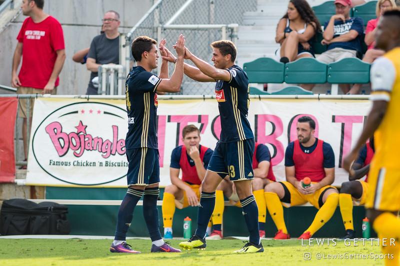 North Carolina FC forward Daniel Rios (14) celebrates his goal with North Carolina FC defender Aaron Guillen (33)