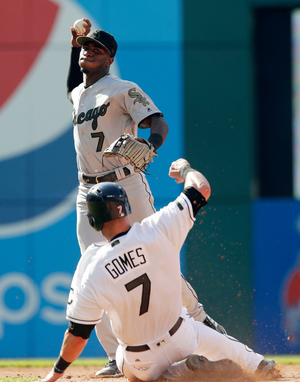 . Chicago White Sox\'s Tim Anderson, top, looks toward first base after getting Cleveland Indians\' Yan Gomes in the fifth inning of a baseball game, Monday, May 28, 2018, in Cleveland. Greg Allen was safe at first base. The Indians won 9-6. (AP Photo/Tony Dejak)