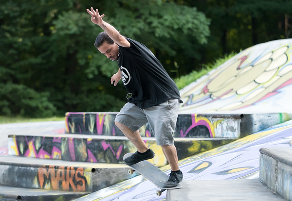 08/09/18 Wesley Bunnell | Staff Carlos Ramos of Newington performs a 5-0 grind at Stanley Quarter Park on Thursday afternoon.