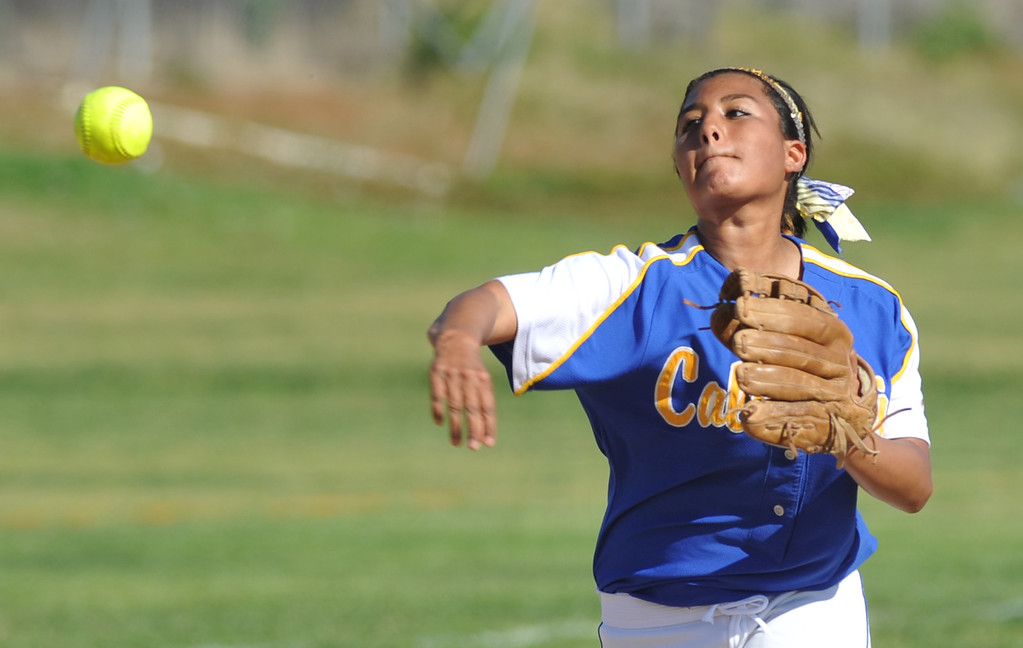 . California shortstop Joslyn Macias (#26) throws out a Bell Gardens runner in their non-league game at California High School in Whittier on Thursday March 14, 2013. California beat Bell Gardens 11-0 in five innings. (SGVN/Staff Photo by Keith Durflinger)