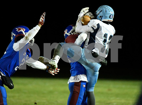 11/22/2017 Mike Orazzi | Staff St. Paul's Connor Lozito (24) and Oxford's Julian Ferrante (10) during Wednesday night's football game in Bristol.