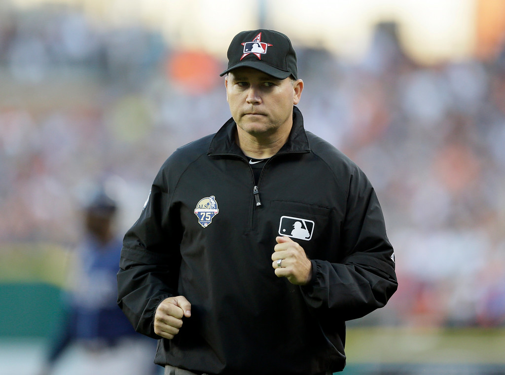 . First base umpire Mark Carlson is seen during the fourth inning of a baseball game between the Detroit Tigers and the Tampa Bay Rays in Detroit, Friday, July 4, 2014. (AP Photo/Carlos Osorio)