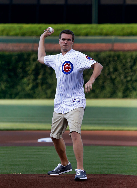 . Dan Cline throws out a ceremonial first pitch before an interleague  baseball game between the Chicago Cubs and the Los Angeles Angels Wednesday, July 10, 2013, in Chicago. (AP Photo/Charles Rex Arbogast)